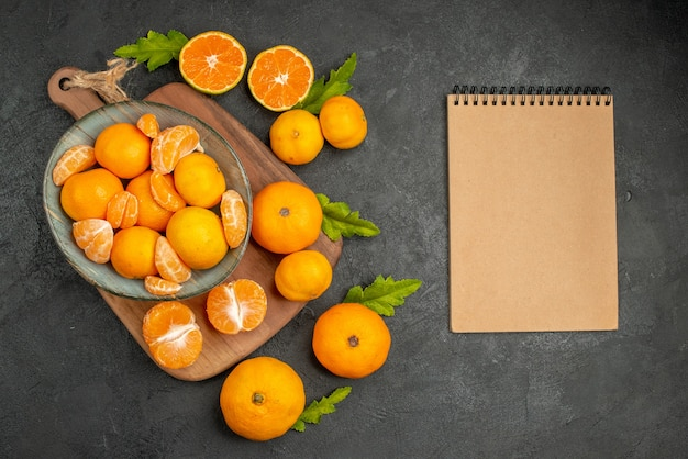 Top view tasty juicy tangerines inside plate on a grey background