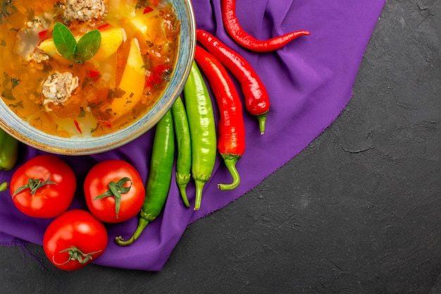 Top view tasty meat soup with fresh vegetables on dark table photo dish color