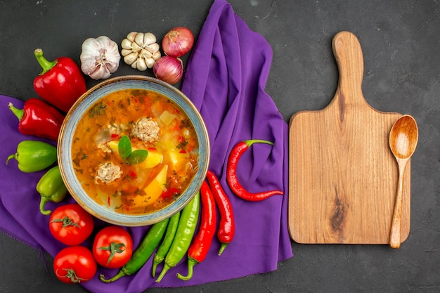 Top view tasty meat soup with fresh vegetables on dark table photo food color dish