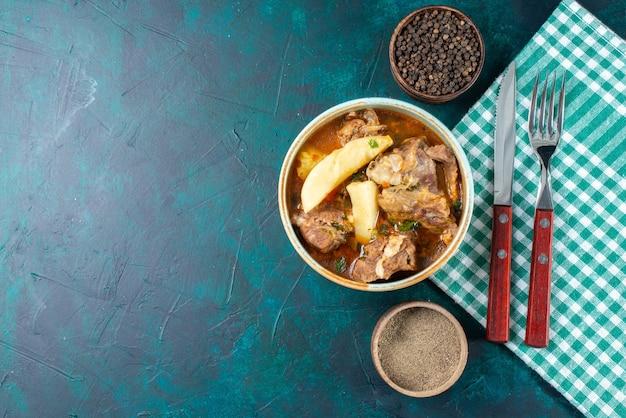 Top view tasty meat soup with vegetables inside on the dark-blue desk meat vegetable food dinner
