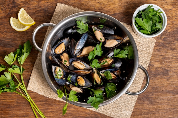 Top view tasty mussel shells with parsley