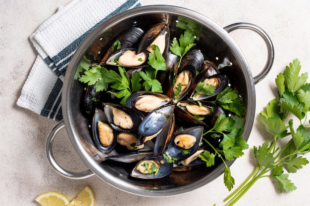 Top view tasty mussels with parsley