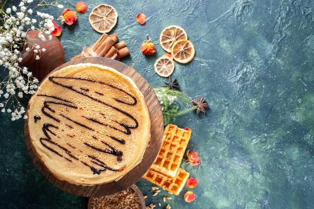 Top view tasty pancakes on a dark-blue background honey morning pie cake breakfast milk dessert sweet