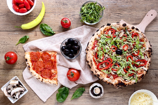 Top view tasty pizza on wooden background