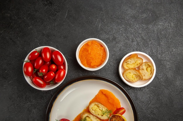 Top view tasty potato pies with pumpkin and fresh tomatoes on grey background bake oven color dish ripe dinner