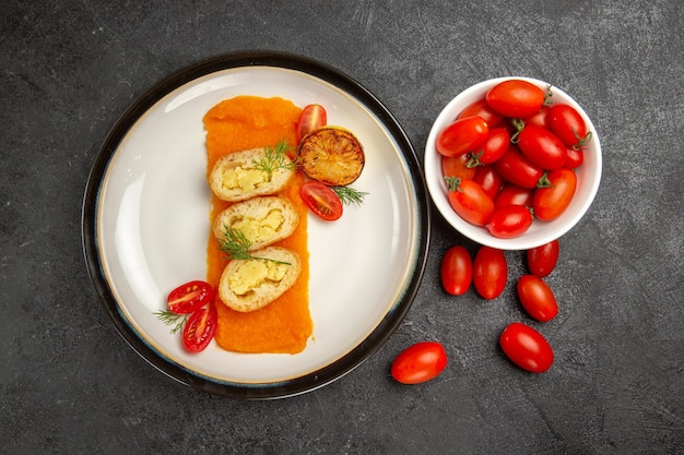 Top view tasty potato pies with pumpkin and fresh tomatoes on grey background oven bake color dish dinner slice