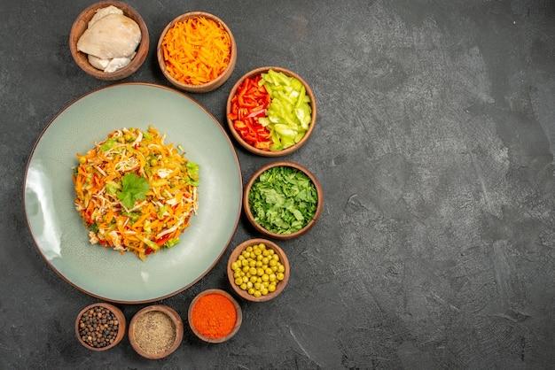 Top view tasty salad with ingredients on grey meal health food diet