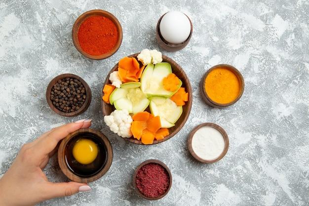 Top view tasty salad with seasonings on white floor salad vegetable meal food health
