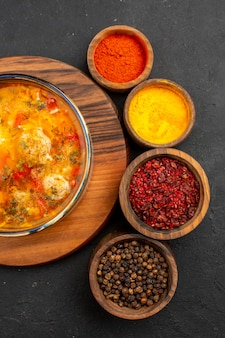 Top view tasty soup with seasonings on grey background soup meal food meat seasoning spicy