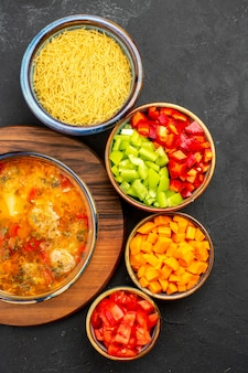 Top view tasty soup with sliced pepper on grey background soup meal food meat seasonings spicy
