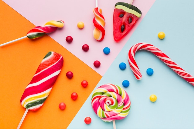 Top view tasty sweets and candy cane