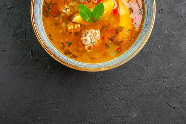 Top view tasty vegetable soup with meat and potatoes on dark table dish photo meal food