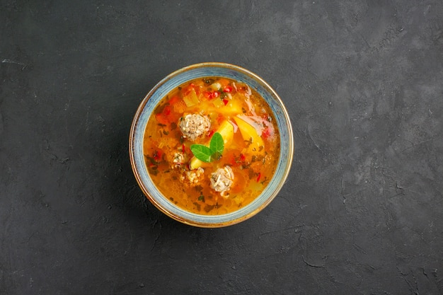 Top view tasty vegetable soup with meat and potatoes on a dark table dish plate meal food