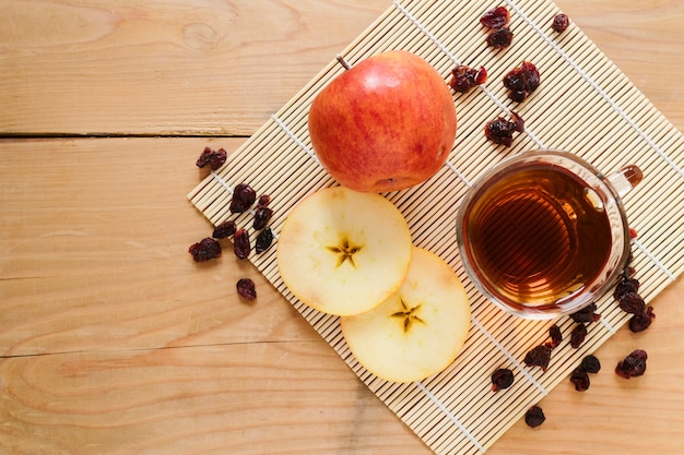 Top view of tea cup with apple