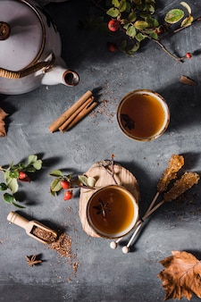 Top view tea in cup with crystallized sugar and cinnamon