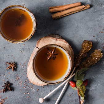 Top view tea in cup with star anise and cinnamon
