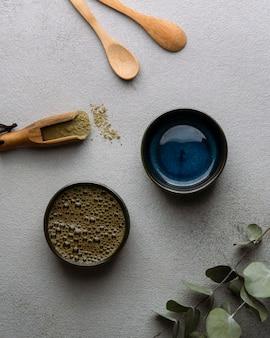 Top view tea cups and powder arrangement