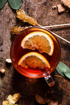Top view tea in glass with lemon and crystallized sugar