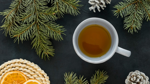 Top view tea with lemon and pine needles