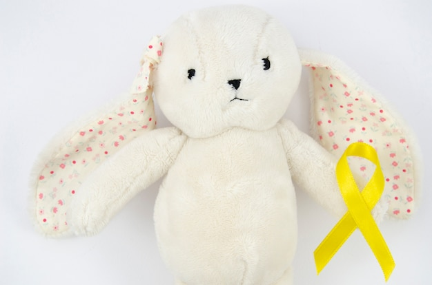 Top view teddy bear with golden ribbon