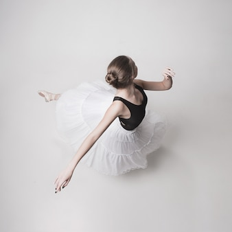 The top view of the teen ballerina on white space