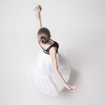 The top view of the teen ballerina on white studio