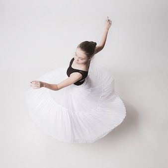 The top view of the teen ballerina on white