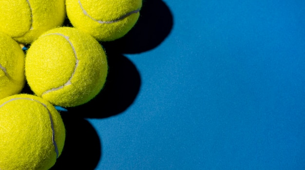Top view of tennis balls with copy space