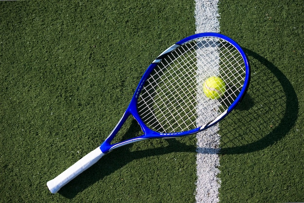 Top view tennis racket on the ball