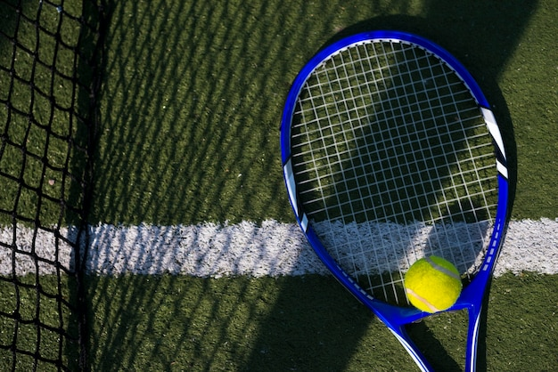 Top view tennis racket with a ball