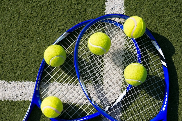 Top view tennis rackets and balls