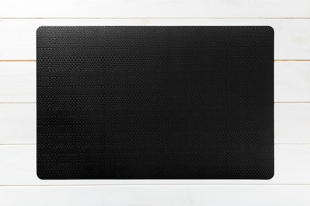 Top view of textile black mat for dinner