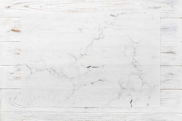 Top view of textile white mat for dinner on wooden