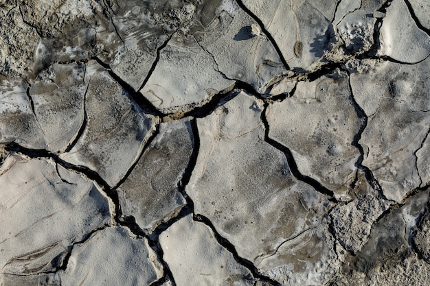 Top view of the texture of a cracked part of a mud volcano closeup