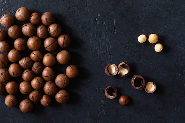 Top view of texture of fresh natural unshelled raw macadamia nuts