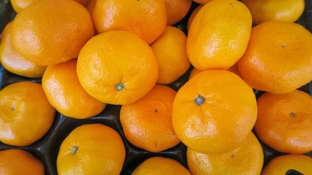 Top view texture of fresh oranges put in box