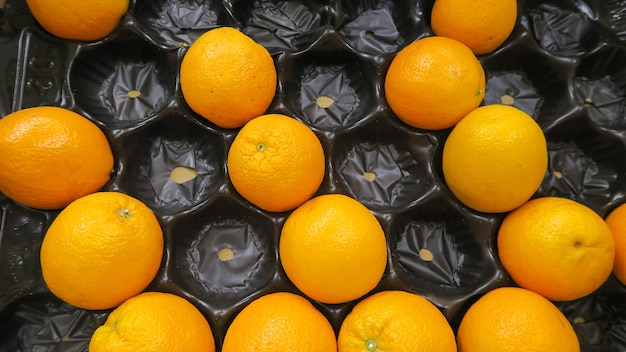 Top view texture of fresh oranges put in tray