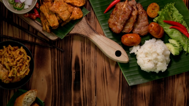 Top view of thai traditional street food with grilled pork