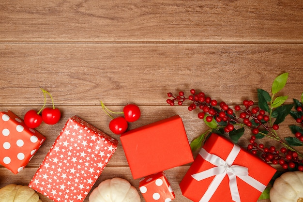 Top view of thanksgiving concepts on wood background, pumpkins, leaves and gift boxes, copy space