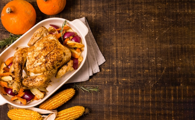 Top view of thanksgiving roasted chicken with corn