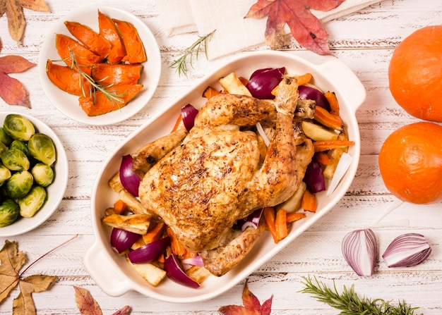 Top view of thanksgiving roasted chicken with ingredients