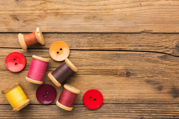 Top view of thread and buttons with copy space