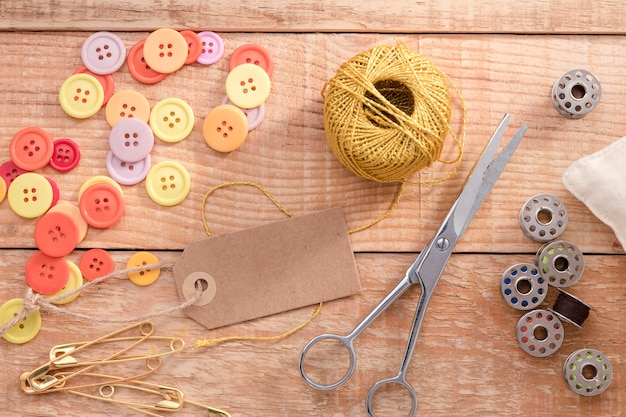 Top view of thread with buttons and scissors