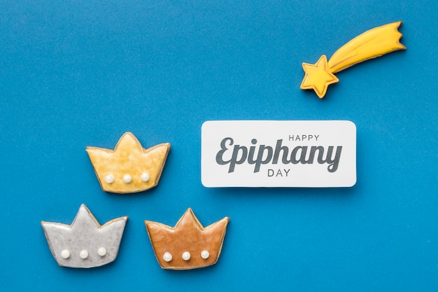 Top view of  three crowns with shooting star for epiphany day