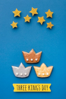Top view of three crowns with stars for epiphany day