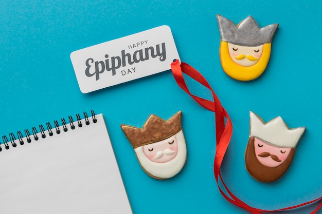 Top view of three kings with notebook and ribbon for epiphany day