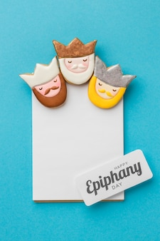 Top view of three kings with paper for epiphany day