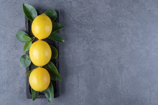 Top view of three lemon in a row.