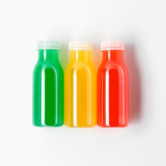 Top view of three multicolored juice bottles
