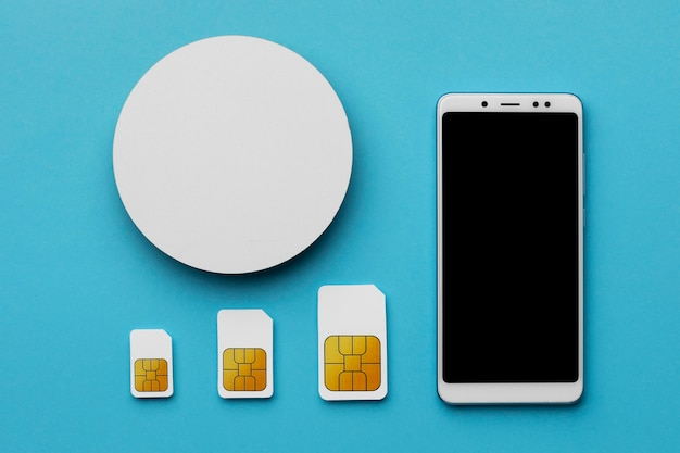 Top view of three sim cards with smartphone